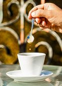Close Up Of A Man Hands Holding A Hot Coffe Cups. Closeup. Coffe Time, Spoon. Black Coffee. Hand Of  poster