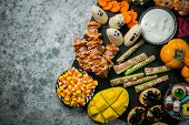 Halloween Party Food - Selection Of Halloween Style Appetizers On Rustic Background poster