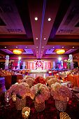 image of centerpiece  - Image of a beautifully decorated ballroom for an Indian wedding reception - JPG