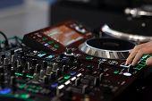 Dj Using A Sound Mixer Controller To Play Music. Selective Focus. poster