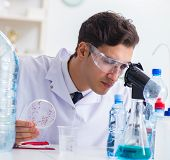 Lab assistant testing water quality poster