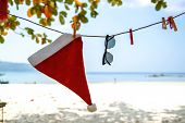 Santa Claus Hat On Caribbean Beach. Beautiful Caribbean Sea And Blue Sky . Christmas Background. poster