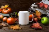 White Coffee Mug Mockup With Fall Maple Leaves, Apples And Pumpkins. Empty Mug Mock Up For Design Pr poster