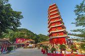 Pagoda And Buddha Sculpture Of Ten Thousand Buddhas Monastery In Hong Kong poster