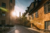 Stockholm, Sweden. Sunshine During Sunset Above Traditional Stockholm Street. Beautiful Street In Su poster