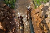image of groundwater  - pumping away groundwater into a small ditch - JPG