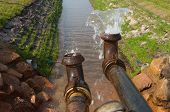 picture of groundwater  - pumping away groundwater into a small ditch - JPG