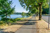 A Landscape Shot Of A Walkway Along Lake Washington In Seattle. poster