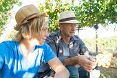 Winemakers Father And Son In Vineyard. Family Winery Business. Wine Grower Man In Straw Hat Examinin poster