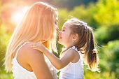 Kids Love. Lifestyle Portrait Mom And Daughter In Happy Mood At The Outside. Happy Loving Family - M poster