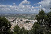 pic of parador  - View of Jaen city through trees from Parador de Jaen Castillo de Santa Catalina in Jaen in Spain - JPG