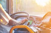Hands Of Driver In A Modern Bus By Driving. Concept Of Bus Driver Steering Wheel And Driving Passeng poster