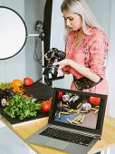 Food Photography. Restaurant Promotion. Female Stylist Working At Studio With Professional Equipment poster