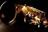 image of saxophones  - Tenor sax golden saxophone macro with selective focus on black - JPG