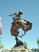 picture of bucking bronco  - Handsome bronze cowboy statue on bucking horse - JPG