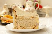 Piece of beige creamy cake with ladyfingers