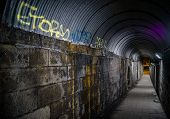 stock photo of underpass  - Urban underpass with graffiti on the wall - JPG