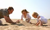Family Building A Sand Castle poster