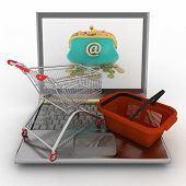 Shopping cart and  basket on laptop. The concept of purchase of consumer goods on the Internet