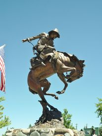 pic of bucking bronco  - Handsome bronze cowboy statue on bucking horse - JPG