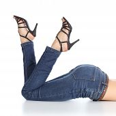 picture of bare butt  - Woman legs lying with jeans and sandal heels pointing up isolated on a white background - JPG