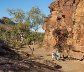 Tourists At Chambers Gorge Aboriginal Engraving Site. Flinders Ranges. South Australia