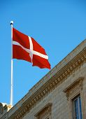 picture of maltese-cross  - Maltese flag close up on the roof of building - JPG