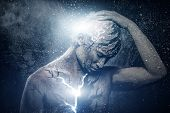 foto of lightning  - Man with conceptual spiritual body art - JPG