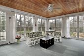 image of screen-porch  - Large porch in suburban home with wood paneled ceiling - JPG
