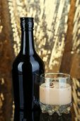 picture of bailey  - Baileys liqueur in bottle and glass on golden background - JPG