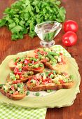 foto of hardtack  - Sandwiches with vegetables and greens on plate on wooden table close - JPG