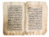 stock photo of islamic religious holy book  - Highly detailed image of Old quran book over white background - JPG