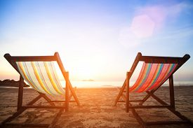 stock photo of sea life  - Beach chairs on the evening sea coast - JPG