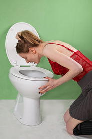 foto of bulimic  - Young bulimic skinny girl vomiting over toilet - JPG