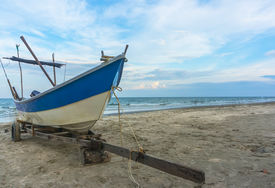 foto of carron  - Traditional Fisherman Wooden Boat with blue skies - JPG