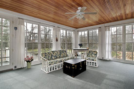 picture of screen-porch  - Large porch in suburban home with wood paneled ceiling - JPG