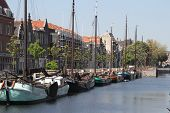 picture of historical ship  - The Historic Delfshaven downtown Rotterdam with old ships and a drawbridge - JPG