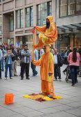 STUTTGART, GERMANY - APRIL 01, 2014: Street actors shows magic trick