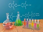 stock photo of beaker  - flasks chemistry and board with chemical formulas - JPG