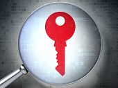 Privacy concept:  Key with optical glass on digital background