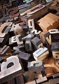 Vintage letterpress printing blocks. Heap of antique printing blocks, different sizes and styles