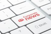 News concept: Business People and Corporate News on keyboard