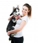 happy girl and husky dog isolated on white background