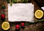 stock photo of pio  - Food background with blank paper in the middle - JPG