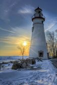 stock photo of marblehead  - The historic Marblehead Lighthouse in Northwest Ohio sits along the rocky shores of Lake Erie - JPG