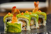 pic of plate fish food  - sushi roll with shrimp tempura at restaurant