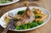 stock photo of parsnips  - Roast duck legs with steamed kale and roast parsnips - JPG
