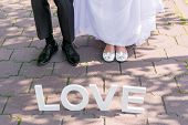 picture of thigh highs  - Feet of groom and bride and white love letters - JPG