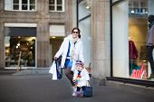 pic of little young child children girl toddler  - Young Beautiful Mother And Her Adorable Toddler Girl Having Fun Together At A Winter Sale Shopping - JPG