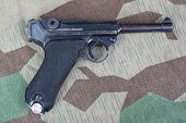 pic of ww2  - P08 Parabellum handgun on ww2 camouflaged background - JPG